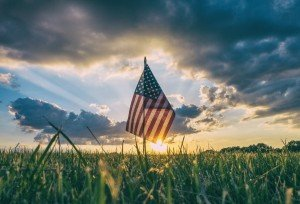 American Flag in a field of grass.