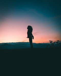 Girls Standing in Front of Sunset