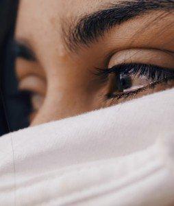 Close up of Eyes behind a White Sheet