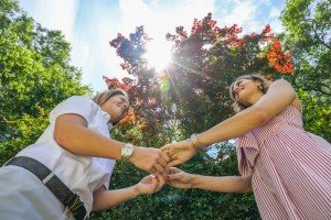 Couple Holding Hands in Sun
