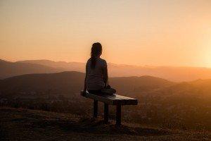 Woman Overlooking Sunset