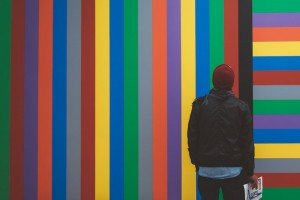 Man in front of colorful wall