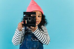 A kid being a creative human with a camera