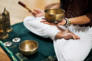 Holding a Sound Healing Bowl on Knee