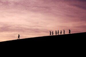 Lead by Example Walking on Hill