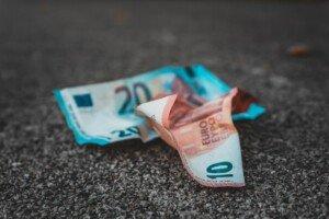 Cash sitting on the pavement
