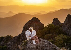 Angel on Mountain at Sunset