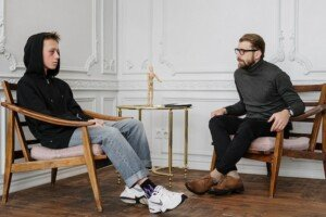 Boy and Man Talking in Therapy